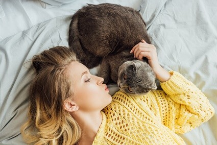 How do cats give humans kisses?